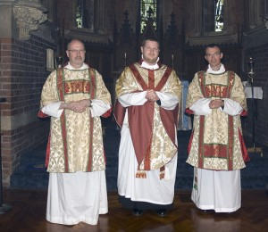 """subdeacon"" in tunicle, priest in chasuble, ""deacon"" in dalmatic"